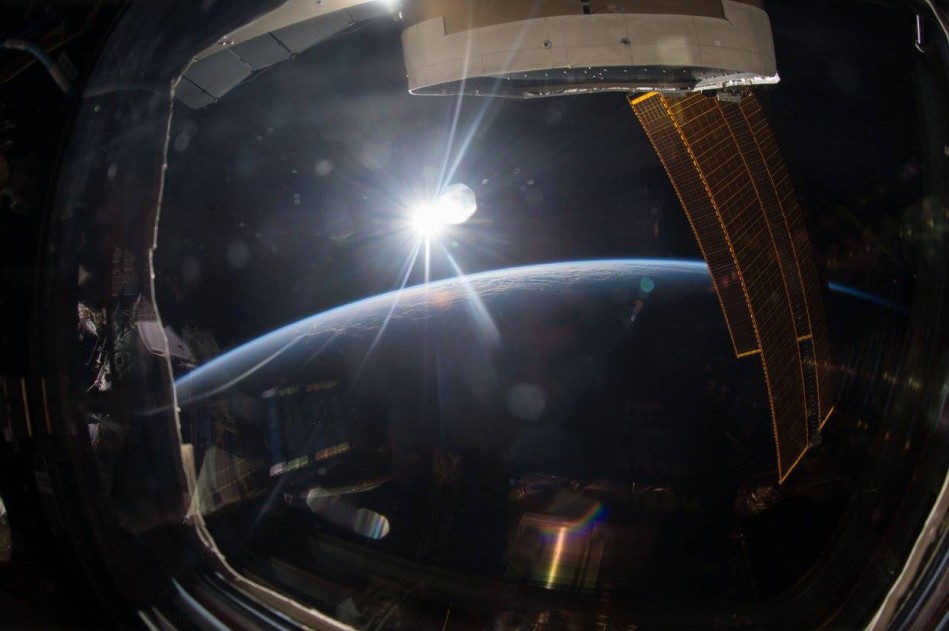 Earth and the Sun photographed from the ISS